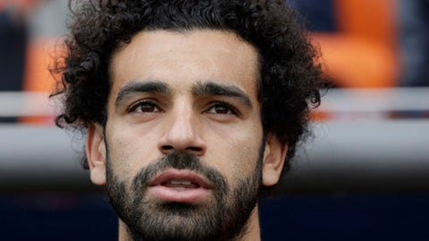 Egypt's Mohamed Salah sings the national anthem ahead the group A match between Egypt and Uruguay at the 2018 soccer World Cup in the Yekaterinburg Arena in Yekaterinburg, Russia, Friday, June 15, 2018. (AP Photo/Mark Baker)