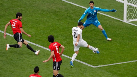 Egypt goalkeeper Mohamed Elshenawy blocks a shot by Uruguay's Luis Suarez during the group A match between Egypt and Uruguay at the 2018 soccer World Cup in the Yekaterinburg Arena in Yekaterinburg, Russia, Friday, June 15, 2018. (AP Photo/Vadim Ghirda)