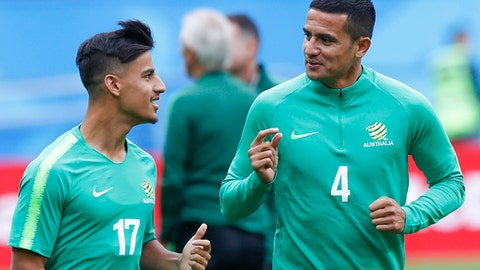 Australia's Tim Cahill, right, and Daniel Arzani talk during Australia's official training for the group C match between France and Australia at the 2018 soccer World Cup in the Kazan Arena in Kazan, Russia, Friday, June 15, 2018. (AP Photo/Pavel Golovkin)
