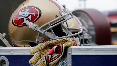 A San Francisco 49ers helmet sits on the equipment case before an NFL football game against the Washington Redskins in Landover, Md., Sunday, Oct. 15, 2017. (AP Photo/Mark Tenally)