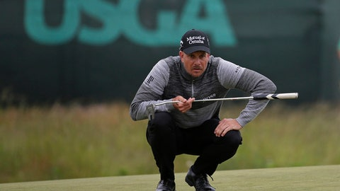 Henrik Stenson of Sweden lines up a shot on the fourth green during the second round of the U.S. Open Golf Championship, Friday, June 15, 2018, in Southampton, N.Y. (AP Photo/Seth Wenig)