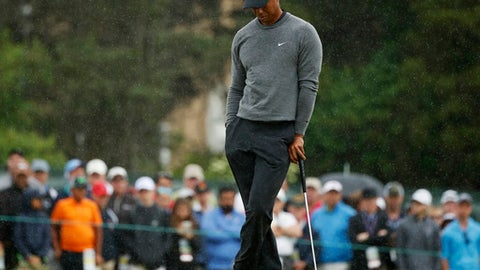 Tiger Woods waits to putt on the 15th green during the second round of the U.S. Open Golf Championship, Friday, June 15, 2018, in Southampton, N.Y. (AP Photo/Carolyn Kaster)