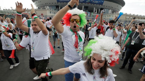 Iranian fans dance in front of 'Saint Petersburg' stadium prior the group B match between Morocco and Iran at the 2018 soccer World Cup in St.Petersburg, Russia, Friday, June 15, 2018. (AP Photo/Dmitri Lovetsky)