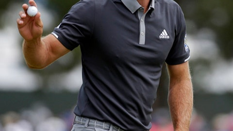 Dustin Johnson reacts after making a putt for birdie on the fourth green during the second round of the U.S. Open Golf Championship, Friday, June 15, 2018, in Southampton, N.Y. (AP Photo/Seth Wenig)