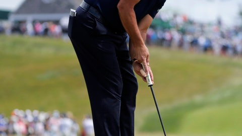 Phil Mickelson putts on the first green during the second round of the U.S. Open Golf Championship, Friday, June 15, 2018, in Southampton, N.Y. (AP Photo/Frank Franklin II)