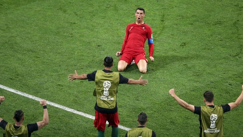 Cristiano Ronaldo scores hattrick to earn Portugal a thrilling draw against Spain class=