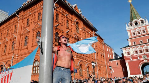 A fan waves an flag of Argentina on the eve of the Group D 2018 World Cup soccer match between Argentina and Iceland at the entrance of the Red Square in Moscow, Russia, Friday, June 15, 2018. (AP Photo/Ricardo Mazalan)