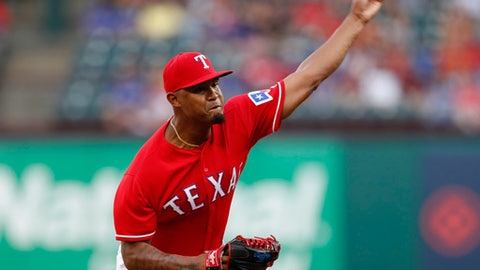 Texas Rangers starting pitcher Yohander Mendez delivers a pitch to a Colorado Rockies batter during the first inning of a baseball game Friday, June 15, 2018, in Arlington, Texas. (AP Photo/Jim Cowsert)