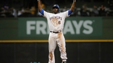 Milwaukee Brewers' Lorenzo Cain reacts after hitting an RBI double during the fourth inning of a baseball game against the Philadelphia Phillies Friday, June 15, 2018, in Milwaukee. (AP Photo/Morry Gash)