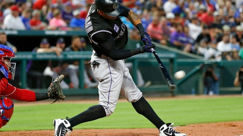 Colorado Rockies' Ian Desmond connects for a home run off Texas Rangers starting pitcher Matt Moore during the fifth inning of a baseball game Friday, June 15, 2018, in Arlington, Texas. (AP Photo/Jim Cowsert)