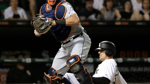Detroit Tigers catcher James McCann, left, looks to the field after forcing out Chicago White Sox's Trayce Thompson at home during the eighth inning of a baseball game in Chicago, Friday, June 15, 2018. (AP Photo/Nam Y. Huh)