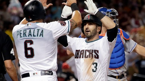 Arizona Diamondbacks Daniel Descalso (3) high-fives David Peralta (6) after hitting a two-run home run against the New York Mets during the fifth inning of a baseball game Friday, June 15, 2018, in Phoenix. (AP Photo/Matt York)