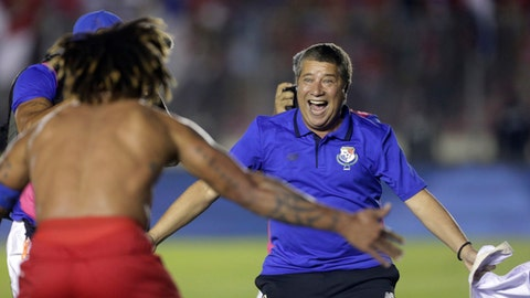 FILE - In this file photo from Oct. 10, 2017, Panama coach Hernan Dario Gomez celebrates with Roman Torres, who scored his team's second goal, after a World Cup qualifying soccer match against Costa Rica in Panama City. (AP Photo/Arnulfo Franco, File)