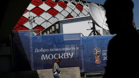 "A fan walks past a sign in Russian saying ""Welcome to Russia"" ahead of the group D match between Argentina and Iceland at the 2018 soccer World Cup in the Spartak Stadium in Moscow, Russia, Saturday, June 16, 2018. (AP Photo/Rebecca Blackwell)"