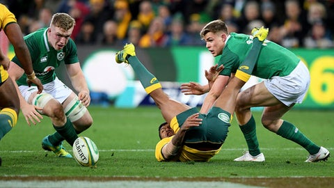 Irealnd's Peter O'Mahony, left and Garry Ringrose, right tackle Australia's Kurtley Beale, centre during the International rugby match between Australia and Ireland in Melbourne, Australia, Saturday, June 16, 2018. (AP Photo/Andy Brownbill)