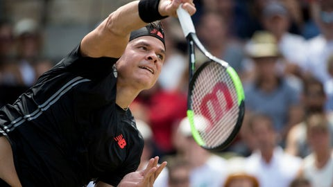 Milos Raonic returns the ball to  Lucas Pouille in their semifinal match during the ATP Mercedes Cup in Stuttgart, Saturday June 16, 2018. (Marijan Murat/dpa via AP)