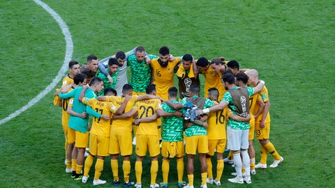 Australia's Mile Jedinak, center, speaks with his teammates after the group C match between France and Australia at the 2018 soccer World Cup in the Kazan Arena in Kazan, Russia, Saturday, June 16, 2018. (AP Photo/Hassan Ammar)