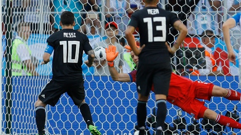 Iceland goalkeeper Hannes Halldorsson makes a save after penalty shot of Argentina's Lionel Messi, left, during the group D match between Argentina and Iceland at the 2018 soccer World Cup in the Spartak Stadium in Moscow, Russia, Saturday, June 16, 2018. (AP Photo/Victor Caivano)