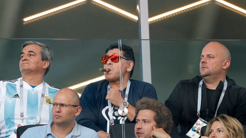 Former soccer star Diego Maradona, center, watches the group D match between Argentina and Iceland at the 2018 soccer World Cup in the Spartak Stadium in Moscow, Russia, Saturday, June 16, 2018. (AP Photo/Ricardo Mazalan)