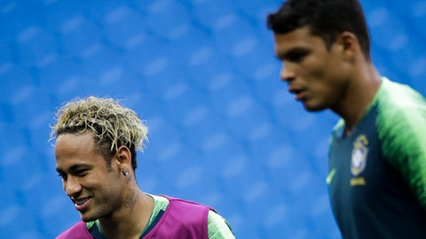 Brazil's Neymar, left and Thiago Silva talk to other players during Brazil's official training on the eve of the group E match between Brazil and Switzerland at the 2018 soccer World Cup in the Rostov Arena in Rostov-on-Don, Russia, Saturday, June 16, 2018. (AP Photo/Felipe Dana)