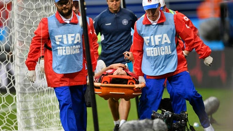 Denmark's William Kvist is carried on a stretcher after getting injury during the group C match between Peru and Denmark at the 2018 soccer World Cup in the Mordovia Arena in Saransk, Russia, Saturday, June 16, 2018. (AP Photo/Martin Meissner)