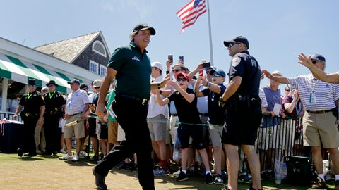 Phil Mickelson greets fans as he arrives for the third round of the U.S. Open Golf Championship, Saturday, June 16, 2018, in Southampton, N.Y. (AP Photo/Seth Wenig)