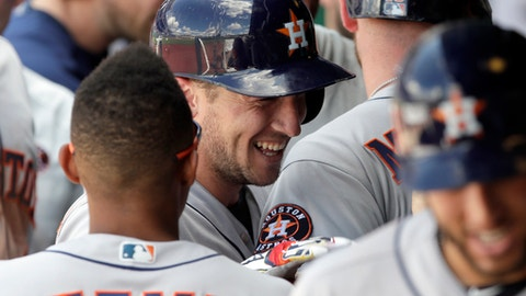 Houston Astros' Alex Bregman, center, celebrates in the dugout with teammates after hitting a three-run home run in the ninth inning of a baseball game against the Kansas City Royals at Kauffman Stadium in Kansas City, Mo., Saturday, June 16, 2018. (AP Photo/Orlin Wagner)