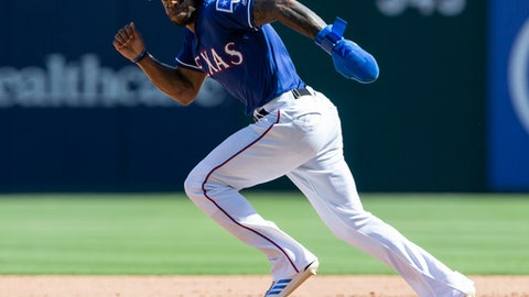 Texas Rangers' Delino DeShields steals second base during the sixth inning of a baseball game against the Colorado Rockies, Saturday, June 16, 2018, in Arlington, Texas. (AP Photo/Sam Hodde)
