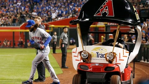 New York Mets relief pitcher Robert Gsellman exits the bullpen cart as he comes in to pitch against the Arizona Diamondbacks during the seventh inning of a baseball game Saturday, June 16, 2018, in Phoenix. (AP Photo/Ross D. Franklin)