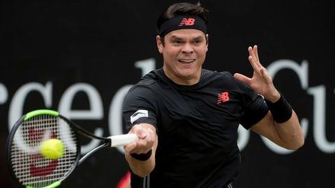 Milos Raonic returns the ball to Roger Federer during the final of the ATP Mercedes Cup in Stuttgart, Sunday June 17, 2018. (Marijan Murat/dpa via AP)