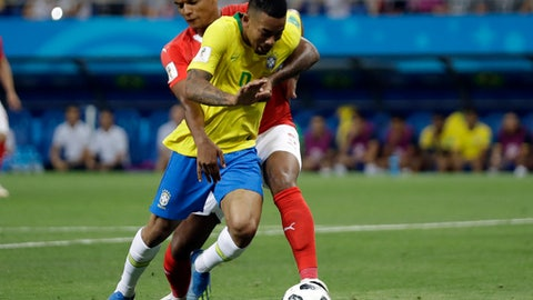 Switzerland's Manuel Akanji rear, and Brazil's Gabriel Jesus challenge for the ball during the group E match between Brazil and Switzerland at the 2018 soccer World Cup in the Rostov Arena in Rostov-on-Don, Russia, Sunday, June 17, 2018. (AP Photo/Felipe Dana)