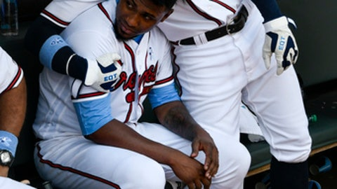 Atlanta Braves' Ender Inciarte, right, hugs to Atlanta Braves starting pitcher Julio Teheran (49) during the sixth inning of a baseball game against the San Diego Padres, Sunday, June 17, 2018, in Atlanta. (AP Photo/John Amis)