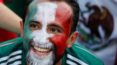A Mexico's football fan smiles ahead of the group F match between Germany and Mexico at the 2018 soccer World Cup in the Luzhniki Stadium in Moscow, Russia, Sunday, June 17, 2018. (AP Photo/Alexander Zemlianichenko)