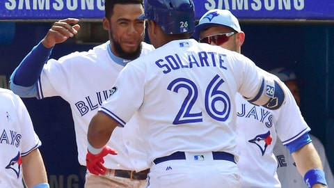 Toronto Blue Jays third baseman Yangervis Solarte (26) celebrates his solo home run against the Washington Nationals with Teoscar Hernandez during eighth inning interleague baseball action in Toronto on Sunday, June 17, 2018. (Frank Gunn/The Canadian Press via AP)