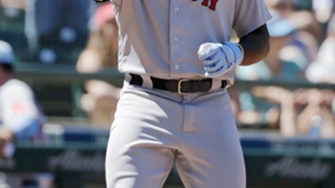 Boston Red Sox's Jackie Bradley Jr. points skyward after hitting a solo home run on a pitch from Seattle Mariners' Chasen Bradford during seventh inning of a baseball game, Sunday, June 17, 2018, in Seattle. (AP Photo/John Froschauer)