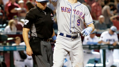 New York Mets' Brandon Nimmo reacts after hitting a two run home run against the Arizona Diamondbacks in the ninth inning during a baseball game, Sunday, June 17, 2018, in Phoenix. (AP Photo/Rick Scuteri)