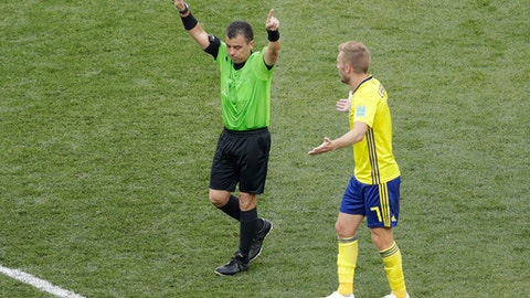 Referee Joel Aguilar of Salvador signals for video review during the group F match between Sweden and South Korea at the 2018 soccer World Cup in the Nizhny Novgorod stadium in Nizhny Novgorod, Russia, Monday, June 18, 2018. (AP Photo/Michael Sohn)