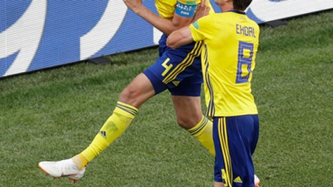 Sweden's Andreas Granqvist, above, and Albin Ekdalduring celebrates after scoring their side's first goal during the group F match between Sweden and South Korea at the 2018 soccer World Cup in the Nizhny Novgorod stadium in Nizhny Novgorod, Russia, Monday, June 18, 2018. (AP Photo/Michael Sohn)