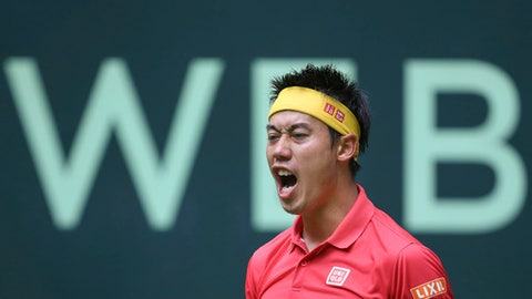 Kei Nishikori reacts during the match against Matthias Bachingerl at the ATP tennis tournament in Halle, Germany, Monday June 18, 2018. (Friso Gentsch/dpa via AP)