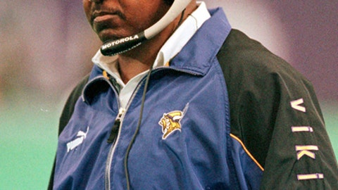 FILE - In this Sept. 3, 2000, file photo, Minnesota Vikings head coach Dennis Green looks up at the clock during a game against the Chicago Bears, in Minneapolis. The Minnesota Vikings will induct former head coach Dennis Green into their Ring of Honor this season. The Vikings announced Monday, June 18, 2018, theyll hold a halftime ceremony with Greens surviving family during their Sept. 23 game against Buffalo. Green died at age 67 in 2016. (AP Photo/Tom Olmscheid, File)