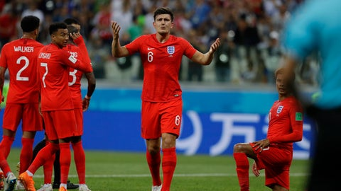 England's Harry Maguire argues with a lineman during the group G match between Tunisia and England at the 2018 soccer World Cup in the Volgograd Arena in Volgograd, Russia, Monday, June 18, 2018. (AP Photo/Alastair Grant)