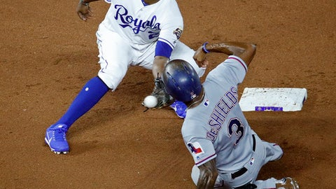 Texas Rangers' Delino DeShields (3) is caught stealing second by Kansas City Royals shortstop Alcides Escobar during the seventh inning of a baseball game Monday, June 18, 2018, in Kansas City, Mo. (AP Photo/Charlie Riedel)