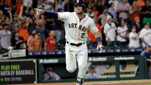 Houston Astros' Alex Bregman points to dugout after hitting a game-winning double to score two runs against the Tampa Bay Rays during the ninth inning of a baseball game Monday, June 18, 2018, in Houston. The Astros won 5-4. (AP Photo/David J. Phillip)