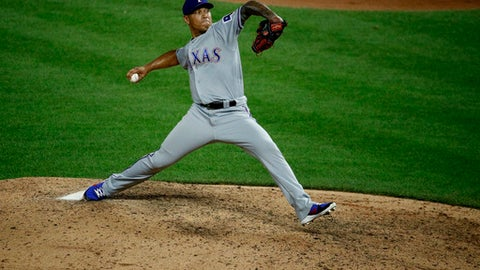 Texas Rangers relief pitcher Keone Kela throws during the ninth inning of a baseball game against the Kansas City Royals Monday, June 18, 2018, in Kansas City, Mo. The Rangers won 6-3. (AP Photo/Charlie Riedel)