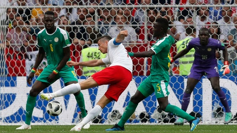 Poland's Robert Lewandowski, 2n left, takes a shot during the group H match between Poland and Senegal at the 2018 soccer World Cup in the Spartak Stadium in Moscow, Russia, Tuesday, June 19, 2018. (AP Photo/Darko Vojinovic)