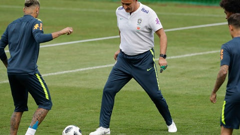 Brazil head coach Tite, right, and Neymar practice during a training session in Sochi, Russia, Tuesday, June 19, 2018. Brazil will face Costa Rica on June 22 in the group E for the soccer World Cup. (AP Photo/Andre Penner)
