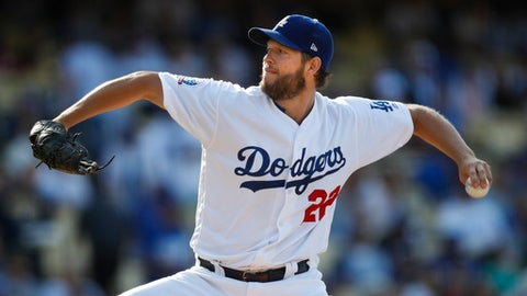 FILE - In this May 31, 2018, file photo, Los Angeles Dodgers starting pitcher Clayton Kershaw throws to a Philadelphia Phillies batter during the third inning of a baseball game in Los Angeles. Kershaw is scheduled make a minor-league rehab start on Saturday as he continues his recovery from a strained lower back. The three-time NL Cy Young Award could be back pitching in the majors soon. (AP Photo/Jae C. Hong, File)