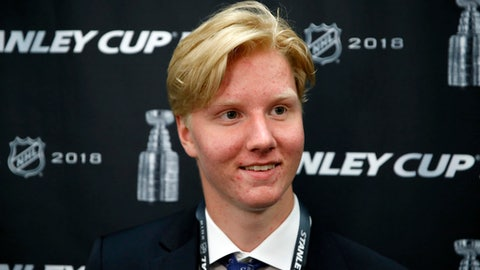 FILE - In this June 4, 2018, file photo, NHL draft prospect Rasmus Dahlin, of Sweden, smiles during a media availability before Game 4 of the NHL hockey Stanley Cup Final between the Washington Capitals and the Vegas Golden Knights, in Washington. With likelihood of selecting Dahlin with the first pick in the draft on Friday, June 22, the Buffalo Sabres are again in a position to end whats been a decade-long freefall. (AP Photo/Alex Brandon, File)