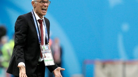 Egypt head coach Hector Cuper shouts during the group A match between Russia and Egypt at the 2018 soccer World Cup in the St. Petersburg stadium in St. Petersburg, Russia, Tuesday, June 19, 2018. (AP Photo/Gregorio Borgia)