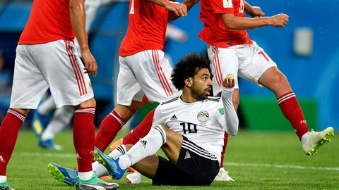 Egypt's Mohamed Salah gestures after he was fouled during the group A match between Russia and Egypt at the 2018 soccer World Cup in the St. Petersburg stadium in St. Petersburg, Russia, Tuesday, June 19, 2018. (AP Photo/Martin Meissner)